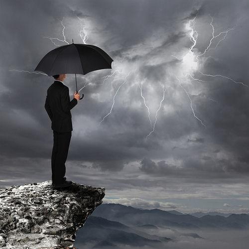bigstock-Business-Man-With-Umbrella-Loo-48506822_blog